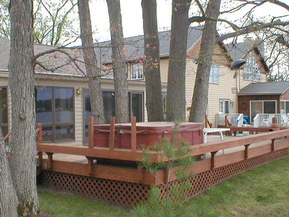 Deck construction how to build a deck deck plans part 3 for Free standing hot tub deck